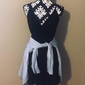 Loose black dress with boyfriend button up.